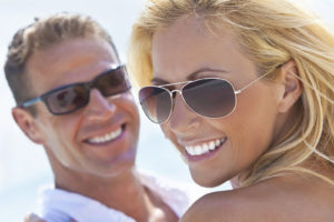 Attractive couple who keep their smiles healthy with general dentistry services from Smiles of Beverly Hills.