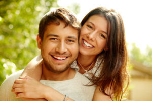Happy Couple with good healthy smiles they got from the general dentistry services at Smiles of Beverly Hills.