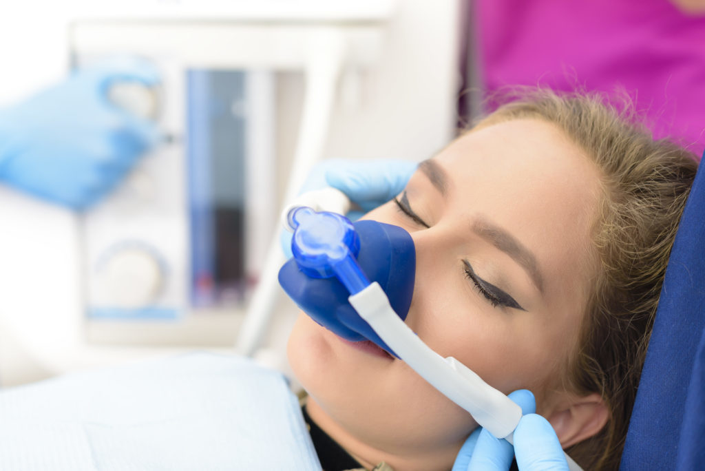 Beautiful woman getting the inhalation sedation dentistry option at Smiles of Beverly Hills.