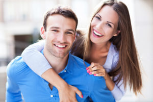 Happy couple showing smiles with no gaps because of the dental bonding services they received at smiles of Beverly Hills.