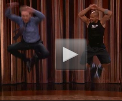 MUST WATCH:  Shaun T From Insanity Kicks Conan O' Brian's Ass