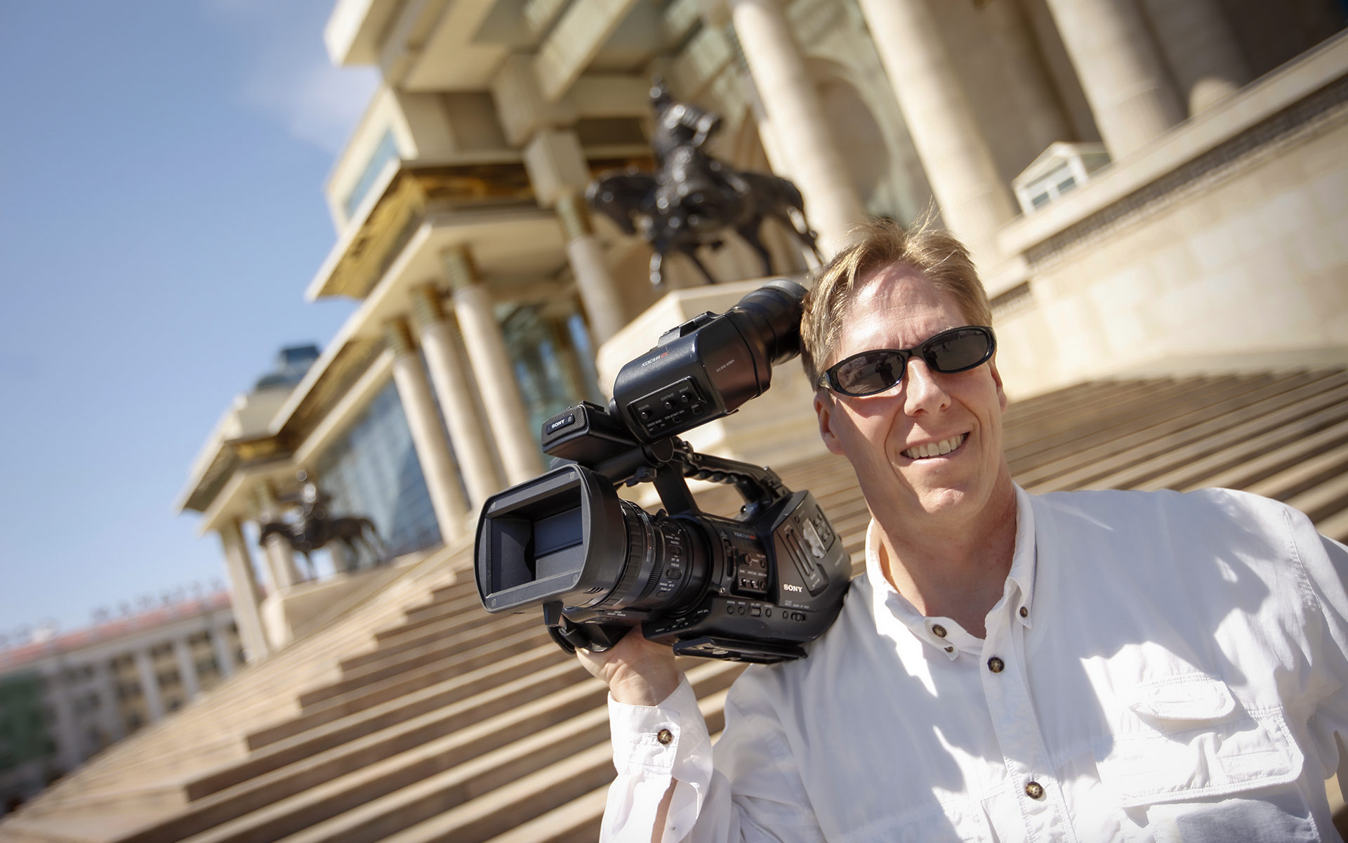 James Dalrymple filming on the Palace Steps in Ulan Bator, Mongolia.