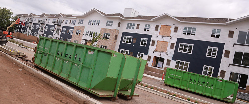 atomic-recycling-rolloff-slide-multihousing