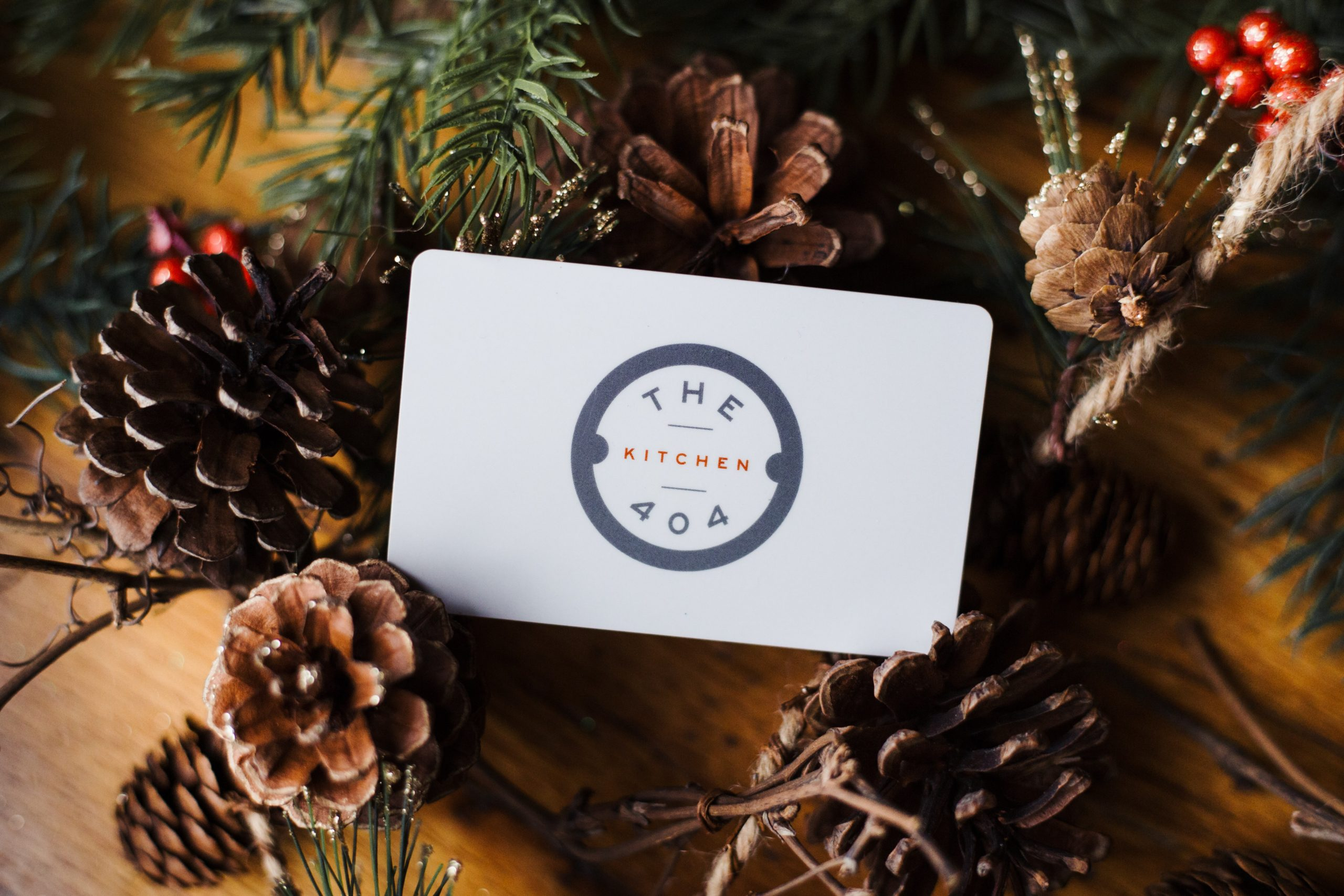 Gift card on a gift box with holiday decorations