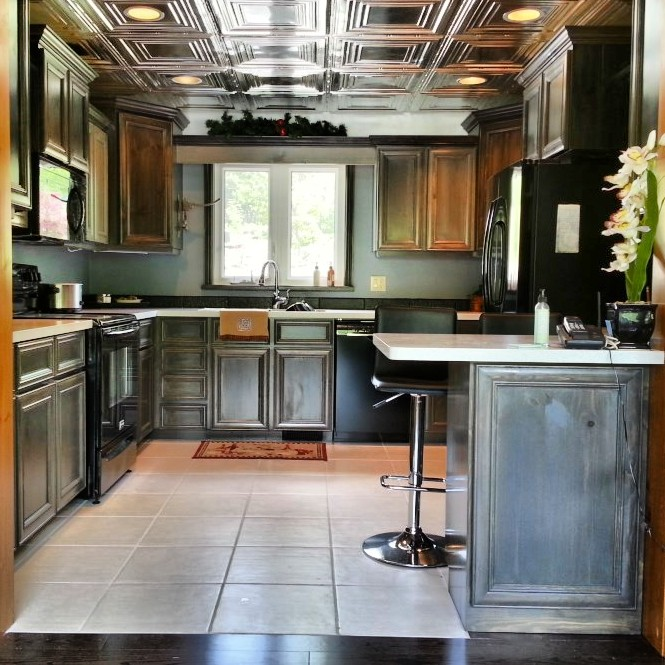 Dark painted new kitchen cupboards