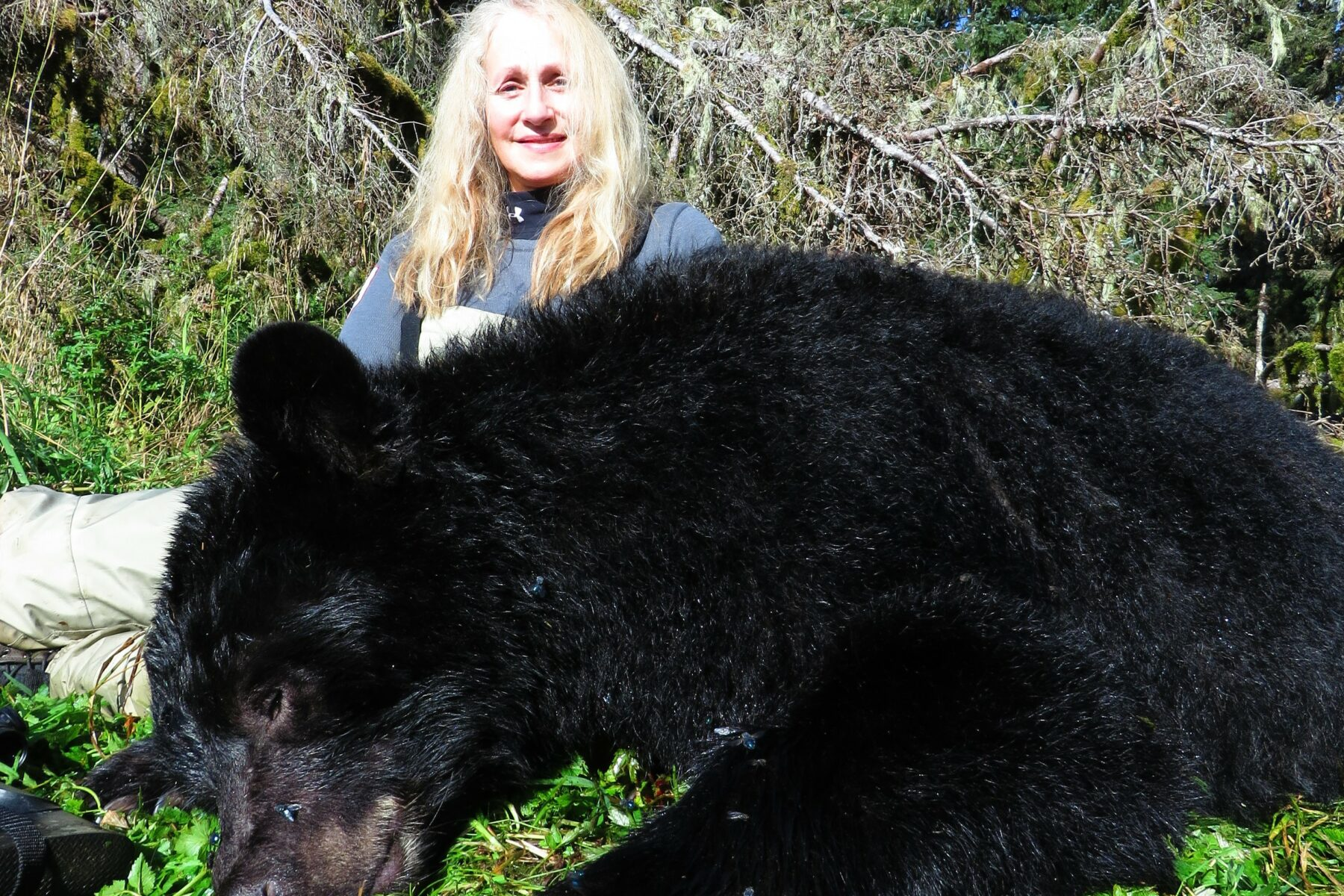 Woman hunter with Black Bear