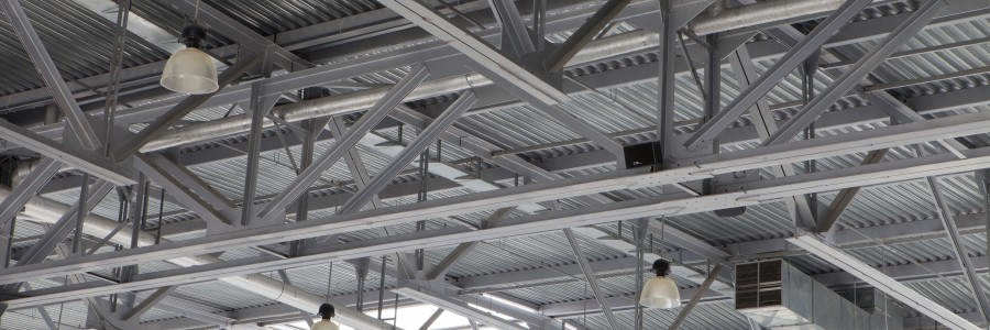 Hughes Environmental performs rafter and ceiling cleaning in industrial and manufacturing facilities