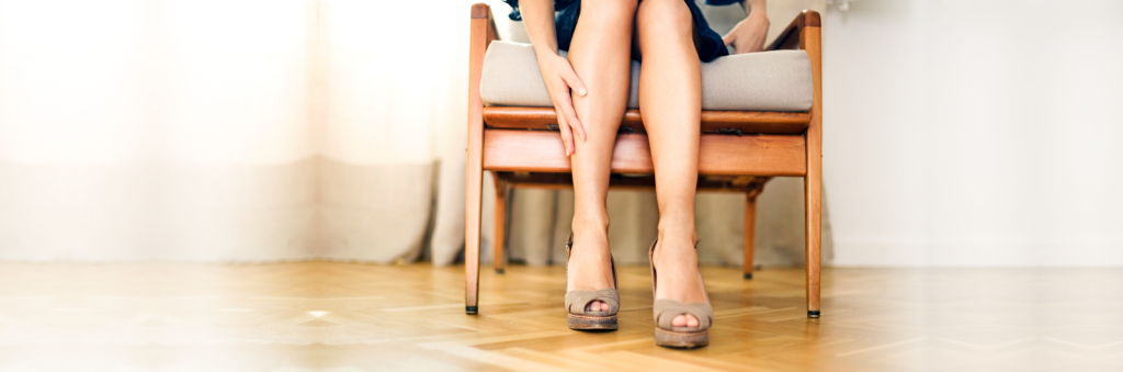 woman sitting in chair with smooth legs after vein treatment