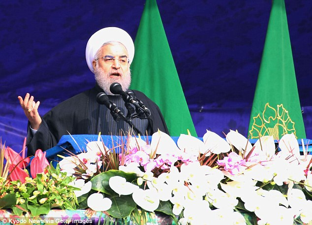 Iranian President Hassan Rouhani (above) speaks during a ceremony in Tehran to commemorate the 38th anniversary of Iran's Islamic fundamentalist revolution on February 10