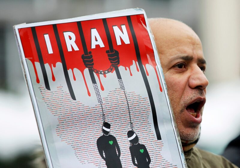 An Iranian exile shouts slogans to protest against executions in Iran