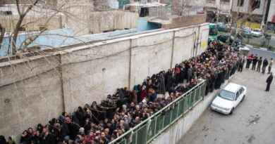 low-income Iranians line up to receive food supplies
