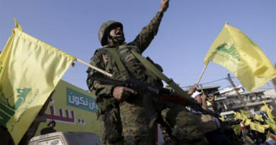 A Hezbollah member reacts while Hezbollah leader Sayyed Hassan Nasrallah talks on a screen during a televised speech at a festival celebrating Resistance and Liberation Day in Nabatiyeh, Lebanon.