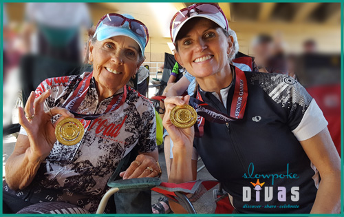 marti davis and stephanie anderson show their gold medals at 2019 Huntsman World Senior Games cycling 20K time trial