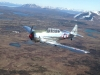 Time to head to Iliamna, pilot Ed Kornfield flying wing with lead pilot Jeff Sever also flying a T-6.