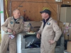 Pilot John Hartke and T-6 Pilots Jeff Sever enjoy lunch provided by Everts Air Service at the Crowley hangar in Iliamna.