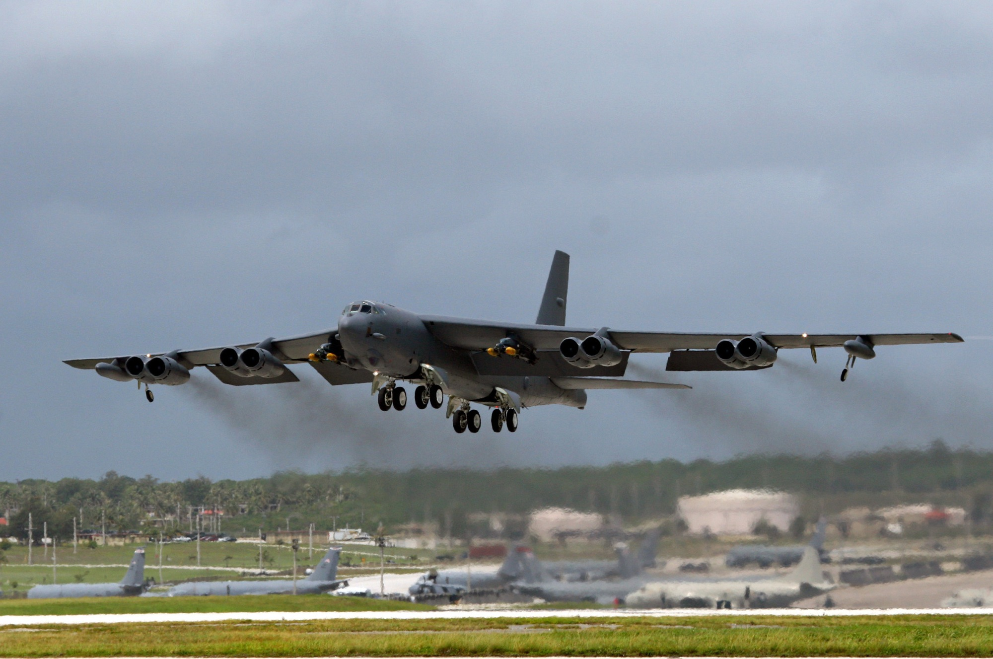 A B-52 bomber, deployed at Andersen Air Force Base, Guam, from Barksdale Air Force Base, La., takes off for September?s Koa Lightning exercise.  For the first time, B-52 crews dropped inert munitions on Pele Bombing Range, Hawaii.  The munitions are made from concrete and have GPS guidance, which make them safe for the environment. This training provides valuable simulated combat experience for the aircrews and translates into raw global combat power against the continuing war on terrorism. (U.S. Air Force photo/Senior Master Sgt. Mahmoud Rasouliyan)
