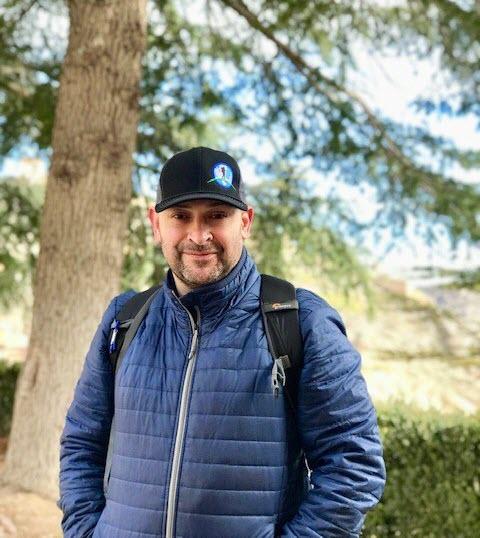 Samuel Garza with tree in background in Albarracin, Spain