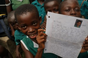 A child with her pen-pal letter.