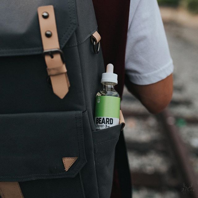 guy with backpack and beard vape ejuice