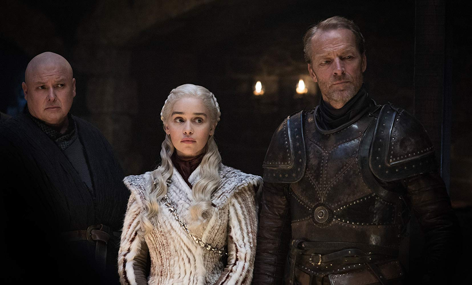 Iain Glen, Conleth Hill, and Emilia Clarke in Game of Thrones (2011)© HBO