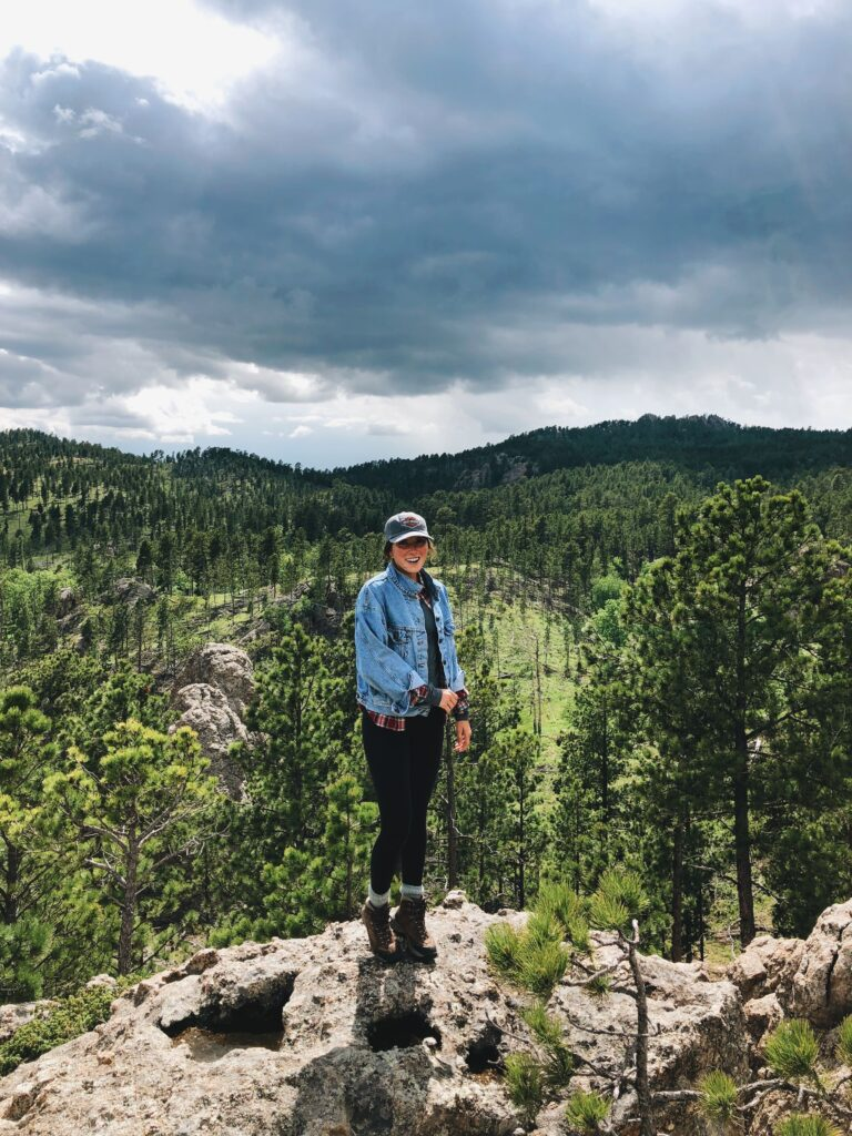 girl standing on mountain