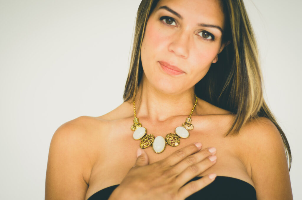 Woman wearing bold statement necklace