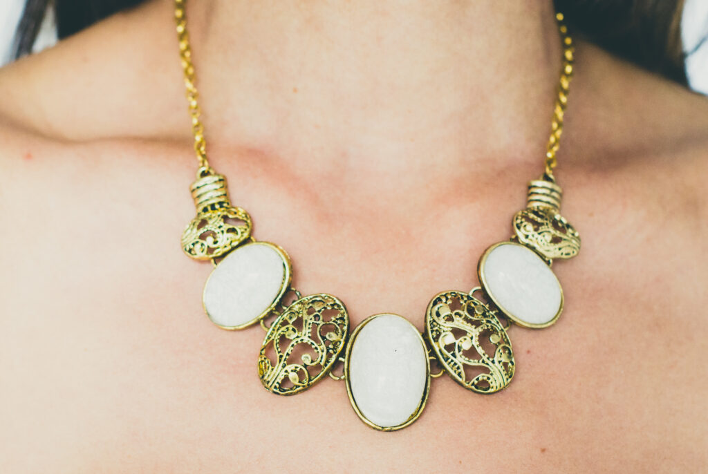 Close up of statement necklace on woman's neck