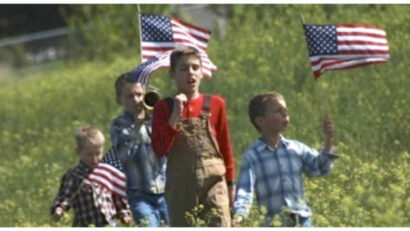Boys having parade to celebrate the USA