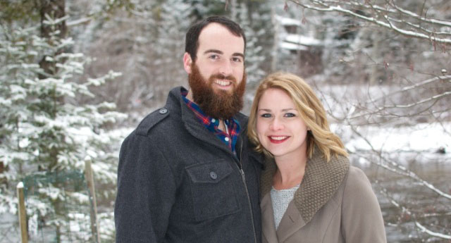Lauren Whalen, Clinical Supervisor, and her husband headshot standing in front of the snowy woods.