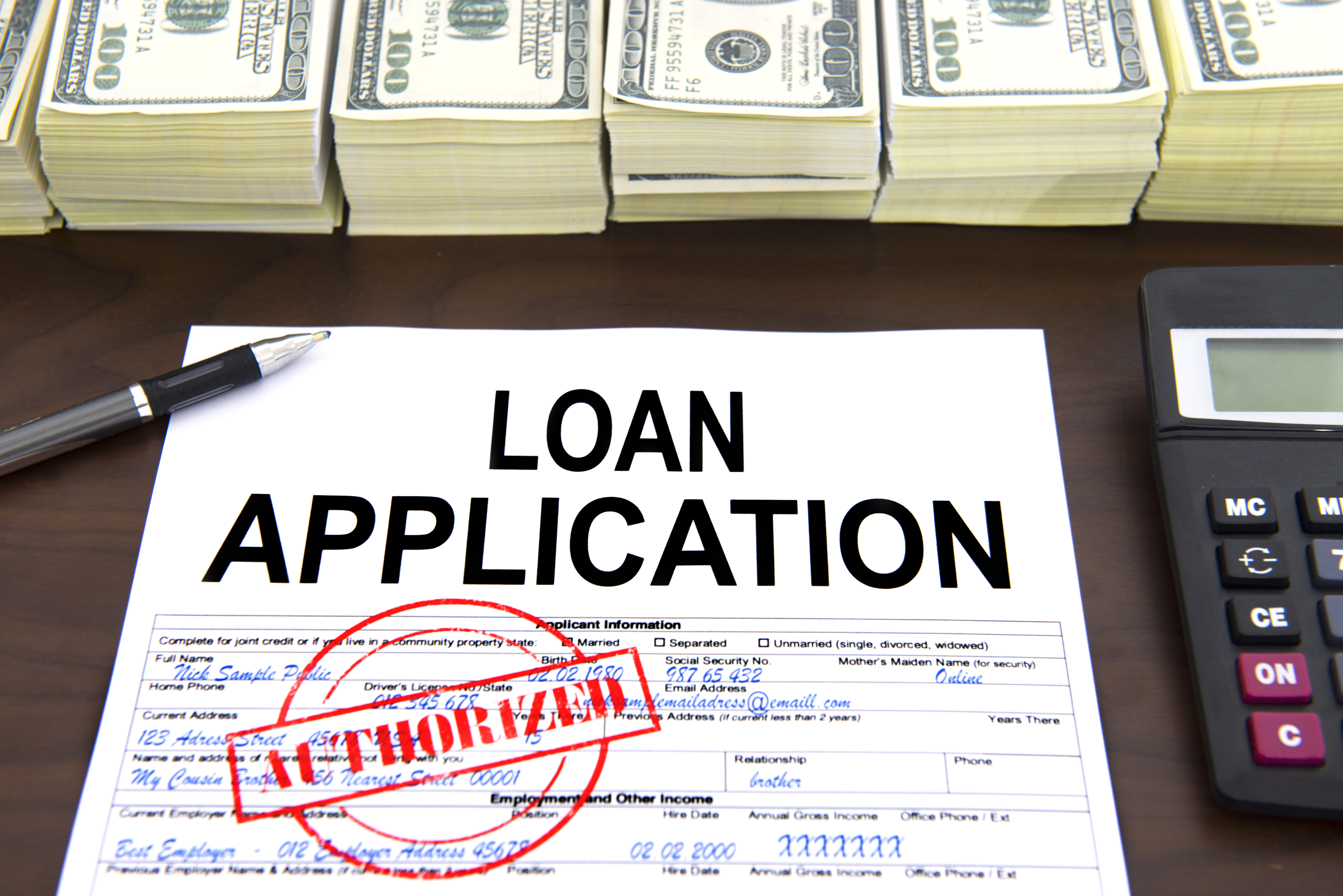 Approved loan application form and dollar bills