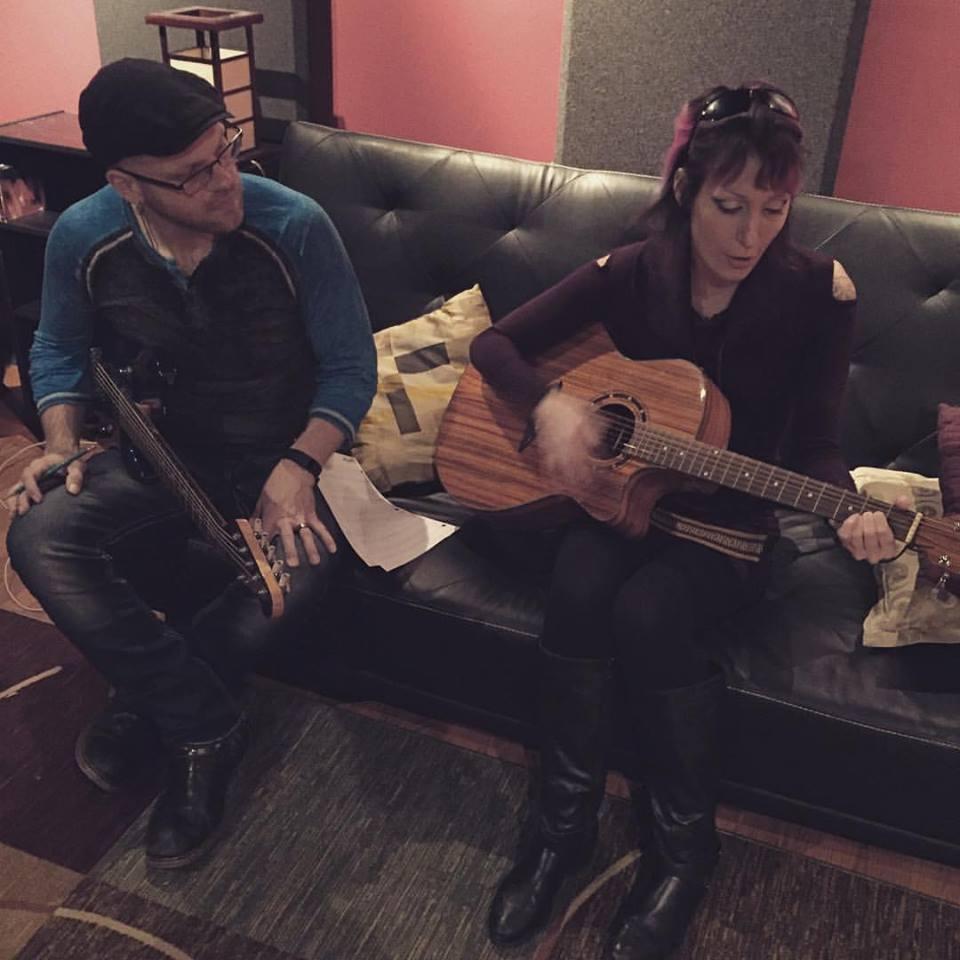 Guitar Teacher Teaching Student