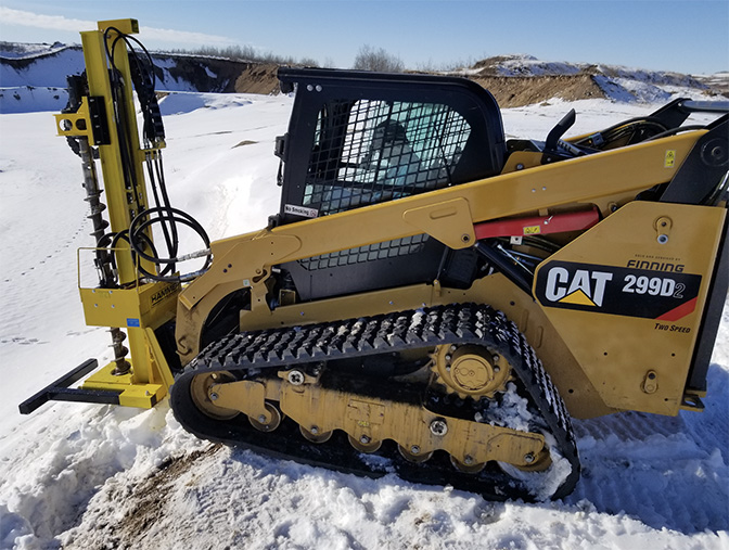 geotechnical drill mast on a skid steer