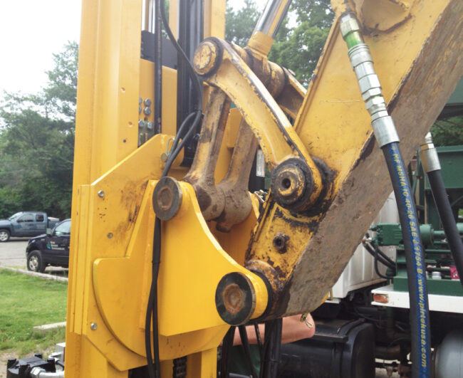 Excavator drilling mast attachment