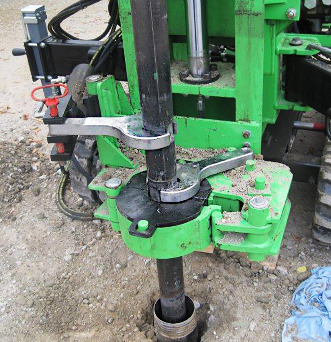 Drill rig breakout clamps with rod wrenches
