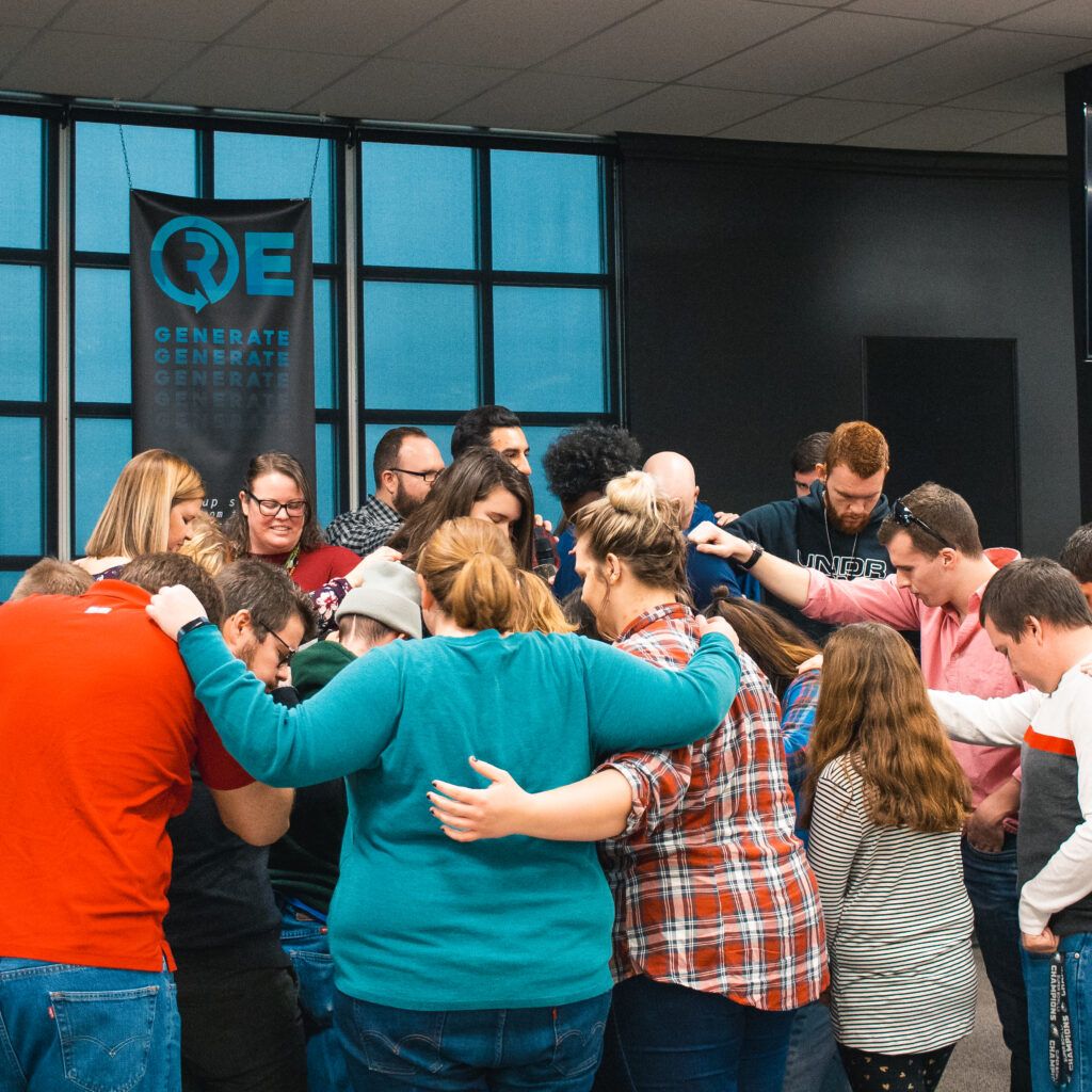 Group of Connect family praying together