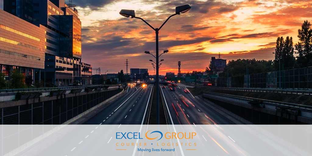 Excel Courier on Route 95 in Richmond, VA at sunset