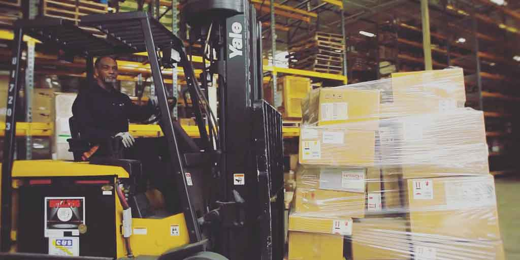 Excel Logistics Staff driving forklift
