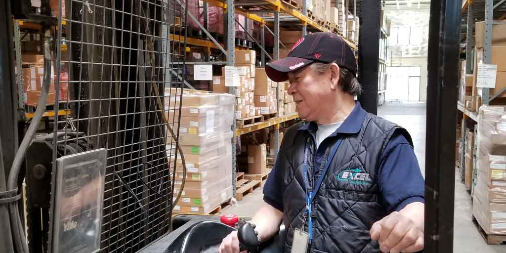 Excel Logistics Staff in an Excel Group Warehouse
