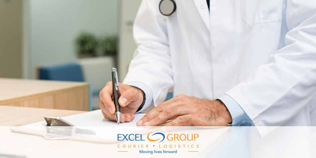 Doctor Signing for a delivery from Excel Medical Courier Services