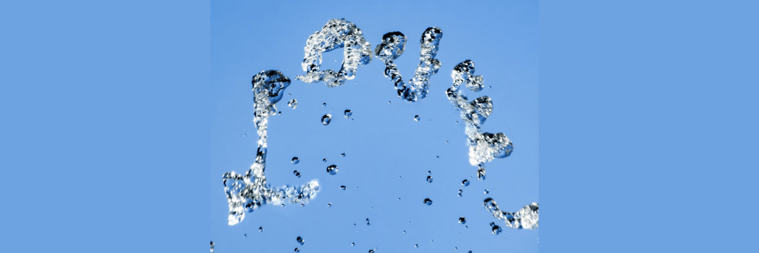 Love written in water droplets in the air