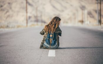 Girl stopped and sitting on a road