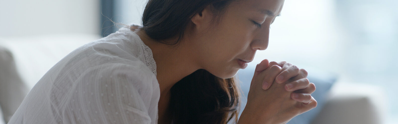 Woman praying to find strength in God