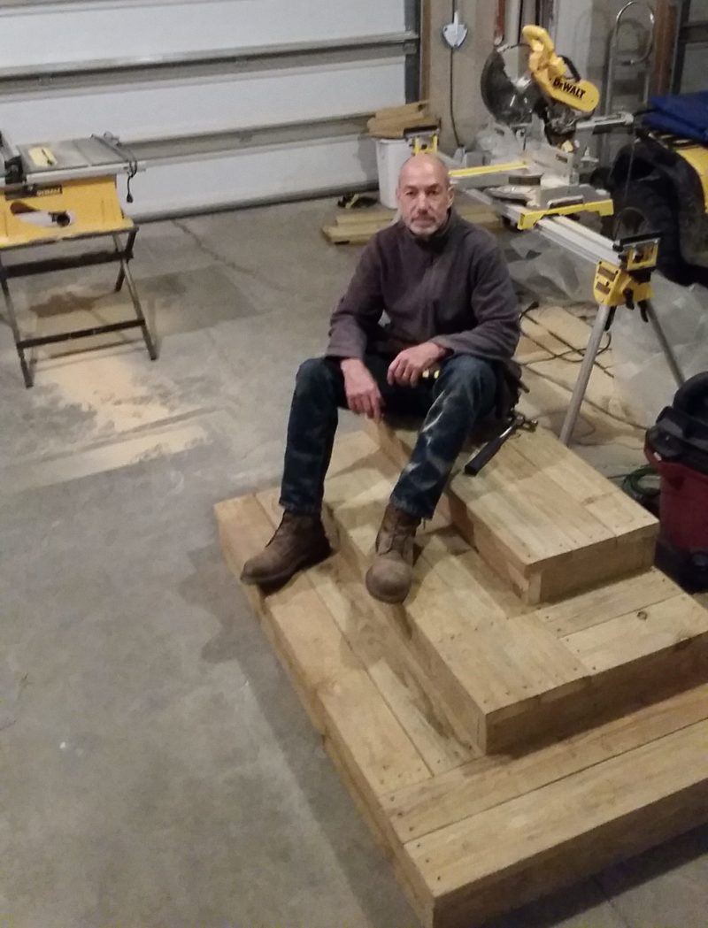Photo of Dean after the completion of heavy duty stair unit for a Rapid City customer.