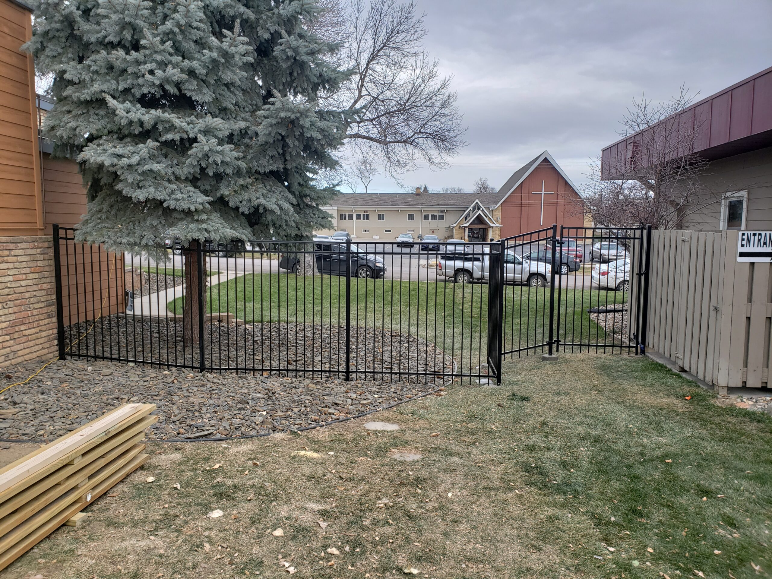 Six foot commercial iron fence.
