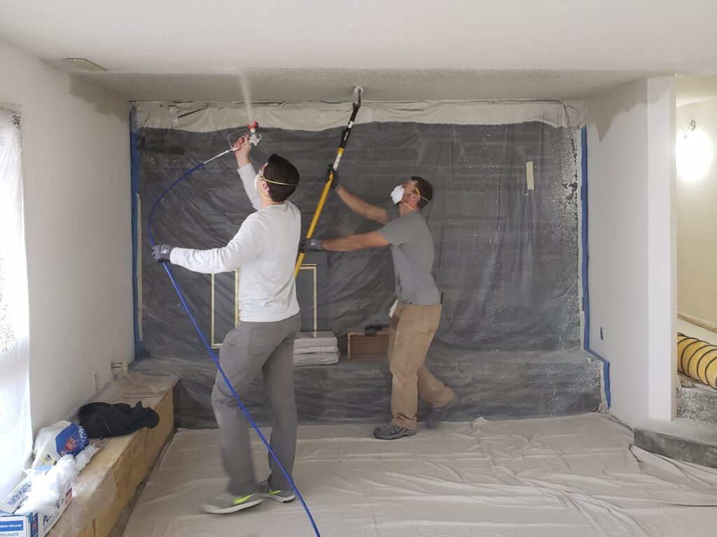 Spraying and back-rolling a basement ceiling