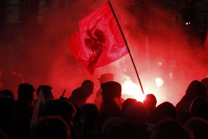 Far-right protesters light flares in front of the building of Russian embassy during the annual far-right march, which coincides with Poland's national Independence Day in Warsaw
