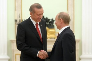 Turkish President Recep Tayyip Erdogan shakes hands with Russian President Vladimir Putin