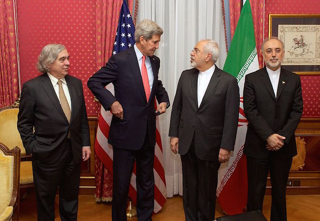 "From left to right: the United States Secretary of Energy Ernest Moniz, the United States Secretary of State John Kerry, the Iranian Foreign Minister Mohammad Javad Zarif and the head of the Atomic Energy Organization of Iran Ali Akbar Salehi, in the ""Salon Élysée"" of the Beau-Rivage Palace (Lausanne, Switzerland) on 16 March 2015 (Photo: Courtesy of WikiCommons)"