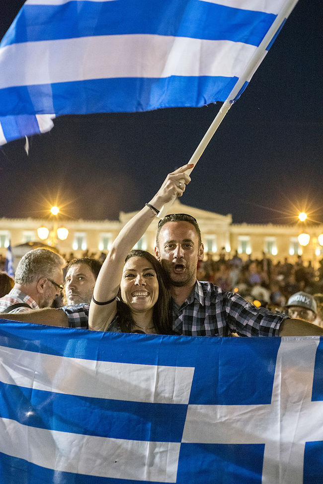 """People celebrating the win of """"NO"""" in the Greek Referndum, Syntagma square, Athens, Greece. (Photo: Courtesy of WikiCommons)"""