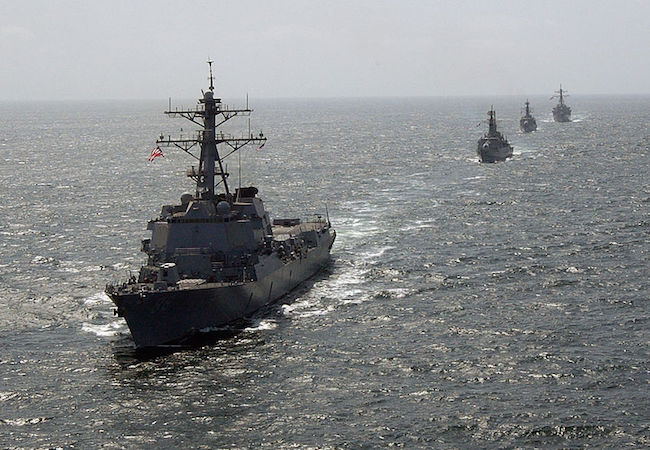 U.S. and Pakistani destroyers maneuver in column formation prior to the commencement of exercise Inspired Siren 2004. USS Preble (DDG 88) in the foreground (Photo: Courtesy of WikiCommons)